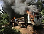 A logging truck burns after it was discovered and set on fire by Ka'apor Indian warriors during a jungle expedition to search for and expel loggers from the Alto Turiacu Indian territory, near the Centro do Guilherme municipality in the northeast of Maranhao state in the Amazon basin