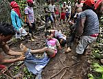 Ka'apor Indian warriors tie up and remove the pants of loggers during a jungle expedition to search for and expel them from the Alto Turiacu Indian territory, near the Centro do Guilherme municipality in the northeast of Maranhao state in the Amazon basin