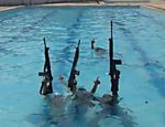 Drug Traffickers Pose With Rifles at Olympic Village Pool