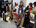 Cosplayers dressed as fantasy and science fiction characters queue to take part in the Cosplay Masquerade competition on the first day of the MCM Comic Con in the Manchester Central exhibition venue in Manchester, north west England on July 29, 2017. / AFP PHOTO / Oli SCARFF ORG XMIT: 2549