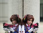 A cosplayer dressed as the character 'D.Va' from Overwatch poses for a photograph outside the Manchester Central exhibition venue which is hosting the MCM Comic Con in Manchester, north west England on July 29, 2017. / AFP PHOTO / OLI SCARFF ORG XMIT: 2537