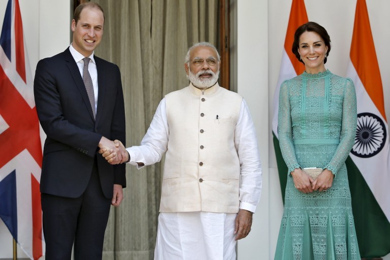 Britain's Prince William shakes hands with India's PM Modi as Catherine, Duchess of Cambridge, smiles during a photo opportunity at Hyderabad House in New Delhi