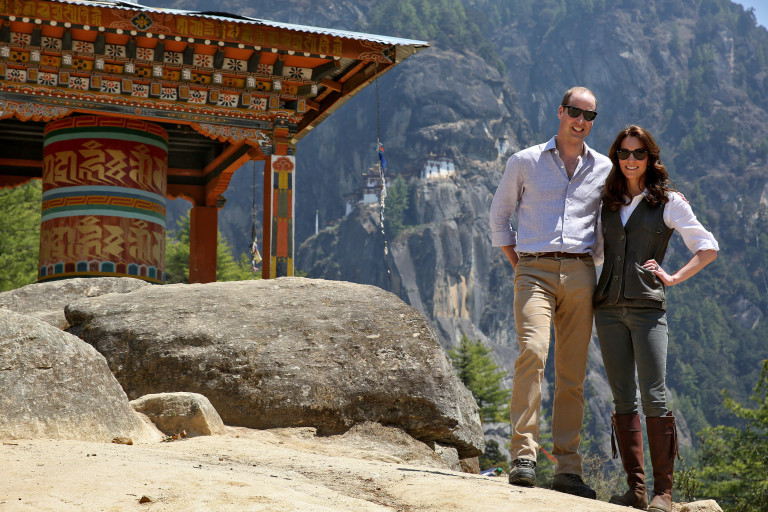 Britain's Prince William, Duke of Cambridge poses with his wife Catherine, Duchess of Cambridge in front of the Paro Taktsang Monastery
