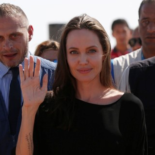 Actress Angelina Jolie leaves after a news conference at Azraq refugee camp for Syrians displaced by conflict near Al Azraq city