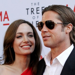 "Pitt and Jolie pose at the premiere of ""The Tree of Life"" at LACMA in Los Angeles"