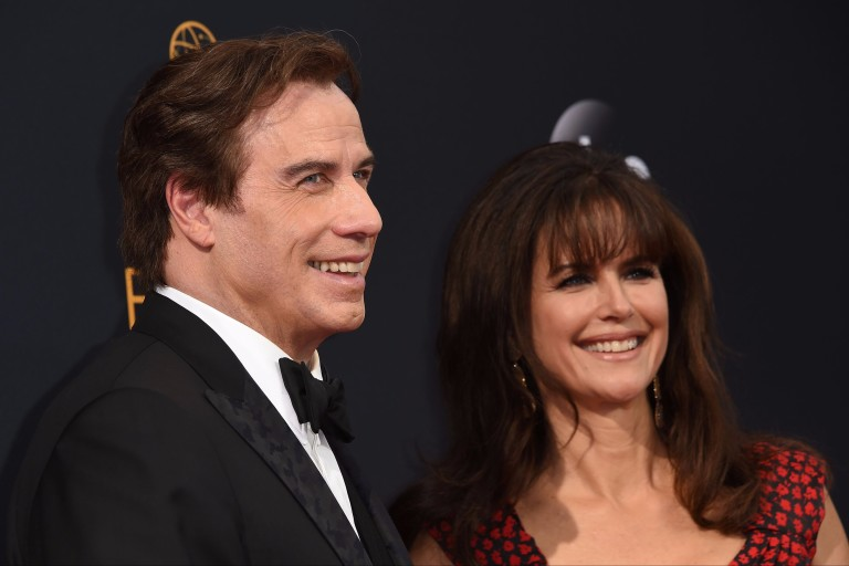 "Outstanding Supporting Actor in a Limited Series or Movie ""People v. O.J. Simpson"" nominee John Travolta (L), and Kelly Preston arrive for the 68th Emmy Awards on September 18, 2016 at the Microsoft T"