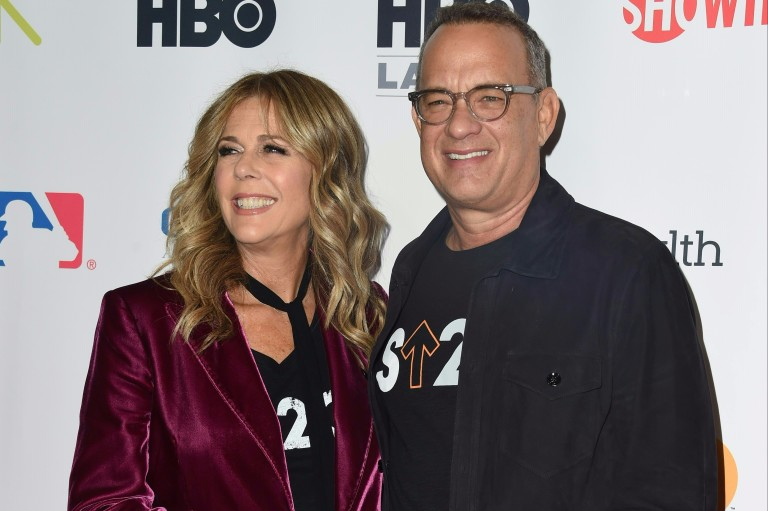 Actors Rita Wilson and Tom Hanks attend the Stand Up To Cancer (SU2C) event on September 9, 2016, at the Walt Disney Concert Hall in Los Angeles, California. / AFP PHOTO / Valerie MACON