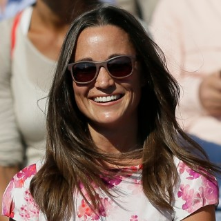 FILE- In this Friday, June 19, 2015 file photo, Pippa Middleton, left, the sister of Kate, the Duchess of Cambridge, watches the quarterfinal tennis match between Canada's Milos Raonic and France's Gilles Simon on the fifth day of the Queen's Championships in London. London police said Saturday, Sept. 24, 2016, they are investigating the reported hacking of the iCloud account of Pippa Middleton, younger sister of Catherine, Duchess of Cambridge. (AP Photo/Tim Ireland, File) ORG XMIT: LON308