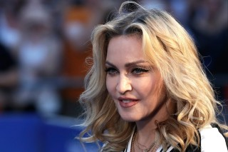 Musician Madonna poses for photographers upon arrival at the World premiere of the film 'The Beatles, Eight Days a Week' in London, Thursday, Sept. 15, 2016. (AP Photo/Kirsty Wigglesworth) ORG XMIT: LKW120