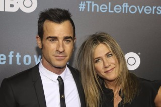 "Justin Theroux, left, and Jennifer Aniston arrive at the second season premiere of ""The Leftovers"" Saturday, Oct. 3, 2015, in Austin, Texas. (Photo by Jack Plunkett/Invision/AP) ORG XMIT: TXJP201"