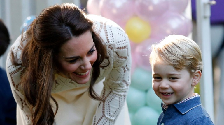 Britain's Catherine, Duchess of Cambridge, looks on as Prince George plays with a bubble gun at a children's party at Government House in Victoria, Thursday, Sept. 29, 2016. (Chris Wattie /The Canadia