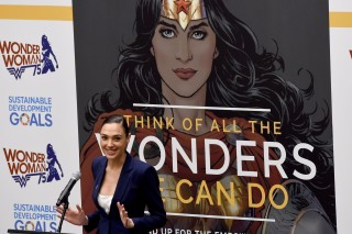 Actress Gal Gadot speaks during a ceremony as the UN names the comic character Wonder Woman its Honorary Ambassador for the Empowerment of Women and Girls during a ceremony at the United Nations Economic and Social Council Chamber on October 21, 2016, in New York.  Gadot plays Wonder Woman in the film to be released in 2017. The honorary title comes as Wonder Woman turns 75 years old.  / AFP PHOTO / TIMOTHY A. CLARY ORG XMIT: TC021