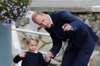 Britain's Prince George waves while holding the hand of Prince William as they prepare to board a floatplane for their official departure from Canada in Victoria, British Columbia, Canada, October 1, 2016. REUTERS/Chris Wattie ORG XMIT: CJW12
