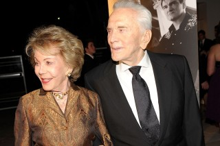 (FILES) This file photo taken on October 22, 2009 shows actress Anne Douglas (L) and actor Kirk Douglas as they arrive at the 4th Annual Kirk Douglas Award for Excellence in Film for the Santa Barbara International Film Festival at the Biltmore Four Seasons Hotel in Santa Barbara, California.    Kirk Douglas, whose illustrious career has taken in some of cinema's landmark roles, turns 100 on December 9, 2016 -- attributing his remarkable longevity to his