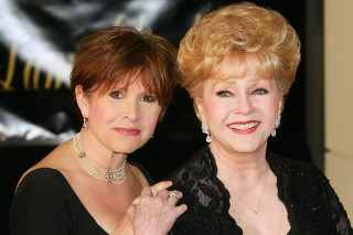 (FILES) This file photo taken on February 27, 2007 shows actress Carrie Fisher (L) and her mother, actress Debbie Reynolds, arriving for Dame Elizabeth Taylor's 75th birthday party at the Ritz-Carlton, Lake Las Vegas. Debbie Reynolds, the