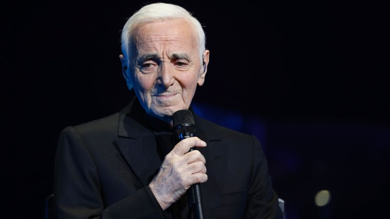 French-Armenian singer Charles Aznavour performs during a concert at the Palais des Sports in Paris on December 21, 2016. / AFP PHOTO / FRANCOIS GUILLOT ORG XMIT: FG8903