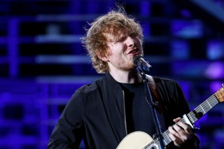 In this Nov. 18, 2015, file photo, Ed Sheeran performs at the Shrine Auditorium on in Los Angeles. Sheeran's mid-tempo guitar- and piano-fueled
