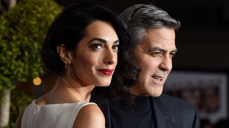 (FILES) This file photo taken on February 2, 2016 shows actor George Clooney and his wife Amal Clooney arriving at The Universal Premiere of Hail, Caesar! at the Regency Village Theatre, in Westwood,