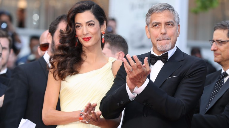 "(FILES) This file photo taken on May 12, 2016 shows US actor George Clooney (R)and  his wife British-Lebanese lawyer Amal Clooney arriving for the screening of the film ""Money Monster"" at the 69th Can"