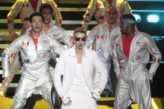 FILE - In this Nov. 10, 2013 file photo, Canada's pop star Justin Bieber performs in concert during his Believe world tour in Buenos Aires, Argentina. A court in Argentina indicted Bieber on Tuesday, Dec. 20, 2016 for allegedly sending his bodyguards to beat up a photographer in Buenos Aires three years ago. (AP Photo/DyN, Pablo Molina, File) ORG XMIT: XLAT118