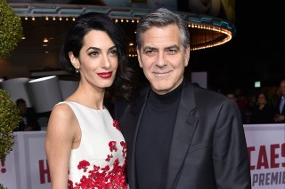 FILE - In this Feb. 1, 2016 file photo, Amal Clooney, left, and George Clooney arrive at the world premiere of