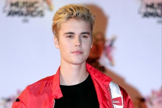 FILE - In this Nov. 7, 2015 file photo, Justin Bieber arrives at the Cannes festival palace in Cannes, southeastern France. Bieber's custom-built 2011 Ferrari 458 Italia is on the auction block. the car can be previewed in person in Scottsdale, Ariz., on Jan. 14 and 15, 2017. (AP Photo/Lionel Cironneau, File) ORG XMIT: PAPM104