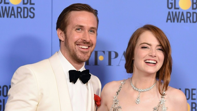 (FILES) This file photo taken on January 09, 2017 shows actors Ryan Gosling and Emma Stone, winners of the Best Performance by an Actor/Actress in a Motion Picture ? Comedy or Musical for 'La La Land'