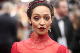 Ruth Negga, wearing the ACLU ribbon, arrives at the Oscars on Sunday, Feb. 26, 2017, at the Dolby Theatre in Los Angeles. (Photo by Matt Sayles/Invision/AP) ORG XMIT: CACV101