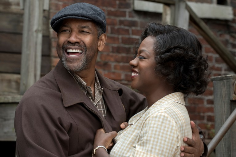 "This image released by Paramount Pictures shows Denzel Washington, left, and Viola Davis in a scene from, ""Fences."" Adapting Wilson's masterpiece has taken more than 30 years. Washington, who directed"