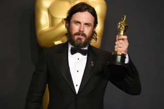 FILE - In this Sunday, Feb. 26, 2017, file photo, Casey Affleck poses in the press room with the award for best actor in a leading role for