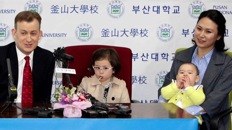 Robert Kelly, left, a political science professor at Pusan National University, holds a press conference with his wife Jung-a Kim, right, and children James and Marion at the university in Busan, Sout