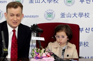 Robert Kelly, left, a political science professor at Pusan National University, holds a press conference with his wife Jung-a Kim, right, and children James and Marion at the university in Busan, South Korea, Wednesday, March 15, 2017. As Kelly speaks from his home office via Skype with BBC about the just-ousted South Korean President Park Geun-hye, his eyes dart left as he watches on his computer screen as his young daughter parades into the room behind him. Her jaunty entrance resembles the exuberant march of the Munchkins celebrating the Wicked Witch's death in the