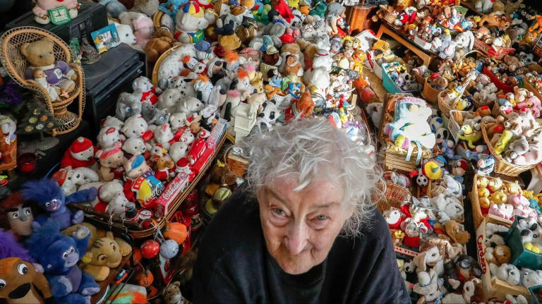 Belgian Catherine Bloemen, 86, stands among more than 20,000 stuffed and plastic toys, she is collecting for more than 65 years, in her house in Brussels