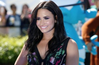"Actor Demi Lovato, who voices the Smurfette character, poses at the premiere of the film ""Smurfs: The Lost Village"" in Culver City, California"