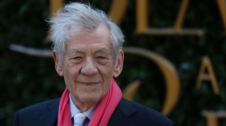Actor Ian McKellen poses for photographers at media event for the film Beauty and the Beast in London