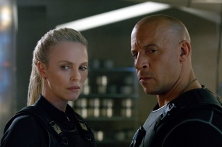 This image released by Universal Pictures shows Charlize Theron, left, and Vin Diesel in