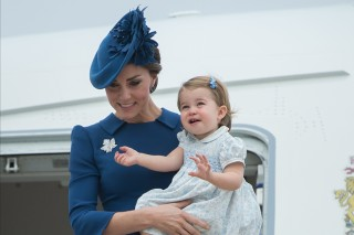 Kate Middleton, The Duchess of Cambridge holds her daughter Princess Charlotte as the family arrives in Victoria, British Columbia, Saturday Sept. 24, 2016. (Jonathan Hayward/The Canadian Press via AP) ORG XMIT: VCRD144 *** ****