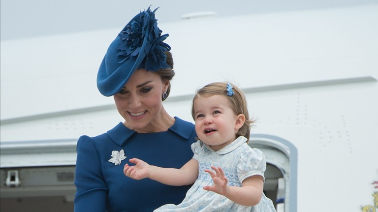 Kate Middleton, The Duchess of Cambridge holds her daughter Princess Charlotte as the family arrives in Victoria, British Columbia, Saturday Sept. 24, 2016. (Jonathan Hayward/The Canadian Press via AP