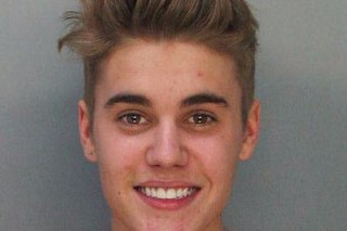 This police booking mug made available by the Miami Dade County Corrections Department shows pop star Justin Bieber, Thursday, Jan. 23, 2014. Bieber and R7B singer Khalil were arrested for allegedly drag-racing on a Miami Beach Street. Police say Bieber has been charged with resisting arrest without violence in addition to drag racing and DUI. Police also say the singer told authorities he had consumed alcohol, smoked marijuana and taken prescription drugs. (AP Photo/Miami Dade County Jail) ORG XMIT: MH101 *** ****