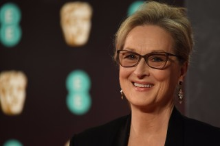 (FILES) This file photo taken on February 12, 2017 shows US actress Meryl Streep upon arrival at the BAFTA British Academy Film Awards at the Royal Albert Hall in London. Meryl Streep is demanding an apology from couture legend Karl Lagerfeld, in a spat over the gown she's planning to wear to the Oscars ceremony, entertainment media reported on February 26, 2017.On the eve of the Academy Awards show, the star actress lashed out at Lagerfeld, head designer and creative director of the illustrious Chanel fashion house, who had accused her of reneging on plans to wear one of its designs on Hollywood's biggest night.  Fashion bible WWD reported last week that Lagerfeld had accused Streep of canceling an order for a couture gown after another fashion house offered to pay her to wear its dress.   / AFP PHOTO / Justin TALLIS