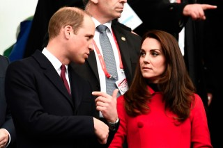 Cambridge's Duke and duchess Prince William and Kate Middleton are seen ahead of the Six Nations tournament Rugby Union match between France and Wales at the Stade de France in Saint-Denis, outside Paris, on March 18, 2017.  / AFP PHOTO / CHRISTOPHE SIMON