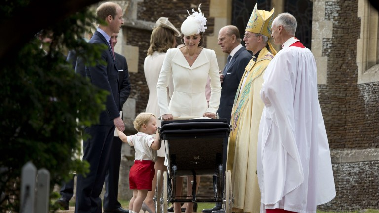 Prince George of Cambridge looks at his sister as his mother, Britain's Catherine, Duchess of Cambridge, father Prince William, Duke of Cambridge (L), and Archbishop of Canterbury Justin Welby (2nd R)