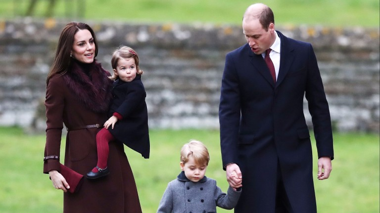 Britain's Prince William and Kate, the Duchess of Cambridge with their children Prince George and Princess Charlotte arrive to attend the morning Christmas Day service at St Mark's Church in Englefiel