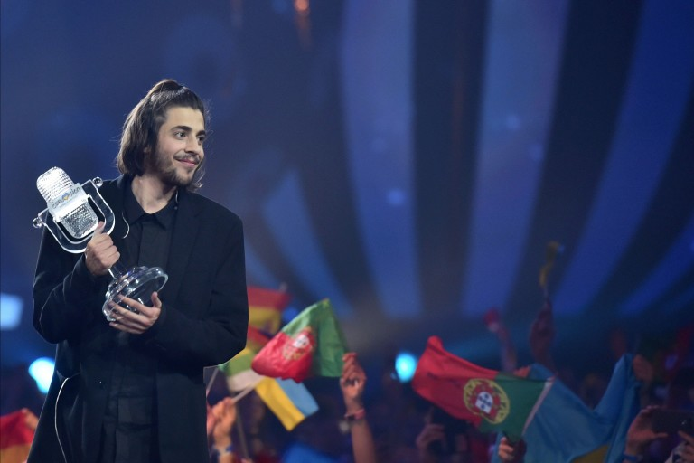 "Portuguese singer representing Portugal with the song ""Amar Pelos Dios"" Salvador Vilar Braamcamp Sobral aka Salvador Sobral holds the trophy as he celebrates on stage after winning during the final of"