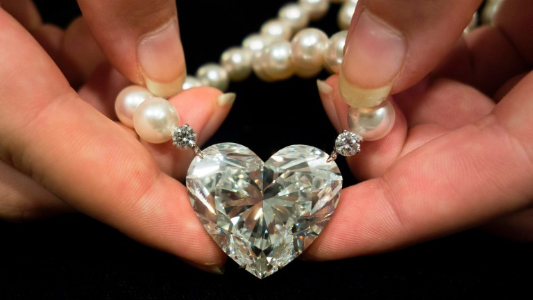 (FILES) This file photo taken on May 03, 2017 shows the 'La Légende' heart-shaped 92 carat diamond being displayed at Christie's in New York.                                 The largest flawless heart