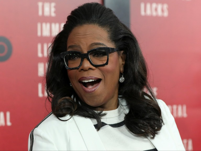 "Oprah Winfrey  smiles at the premiere of ""The Immortal Life of Henrietta Lacks"" in New York"