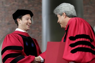 Facebook CEO and Harvard dropout Mark Zuckerberg, left, is presented with an honorary Doctor of Laws degree by Vice President and Secretary of Harvard University Marc Goodheart, right, during Harvard University commencement exercises, Thursday, May 25, 2017, in Cambridge, Mass. (AP Photo/Steven Senne) ORG XMIT: MASR101