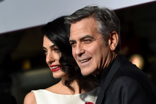 (FILES) File photo dated February 1, 2016 shows actor George Clooney and wife Amal at the Regency Village Theatre, in Westwood, California. George and Amal Clooney welcomed their twin babies, Ella and Alexander, on June 6, 2017   in London, the actor's publicist Stan Rosenfeld said. The 39-year-old human rights lawyer and 56-year-old Hollywood star -- both first-time parents -- tied the knot in Venice in 2014. / AFP PHOTO / Valerie Macon