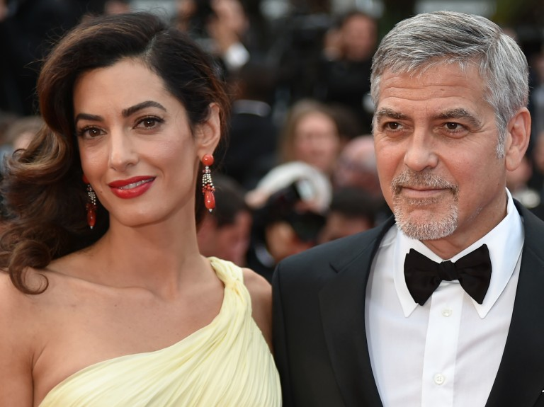 (FILES) File photo dated May 12, 2016 shows US actor George Clooney (L)and his wife Amal Clooney at the 69th Cannes Film Festival in Cannes, southern France.  George and Amal Clooney welcomed their tw