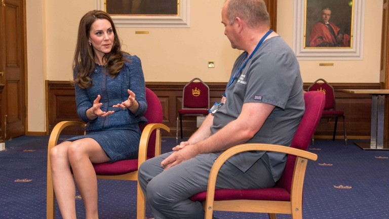 Britain's Catherine, Duchess of Cambridge (L), speaks to Clinical Director and Consultant in Emergency Medicine Dr Malcolm Tunnicliff as she visits Kings College Hospital to meet staff and patients af